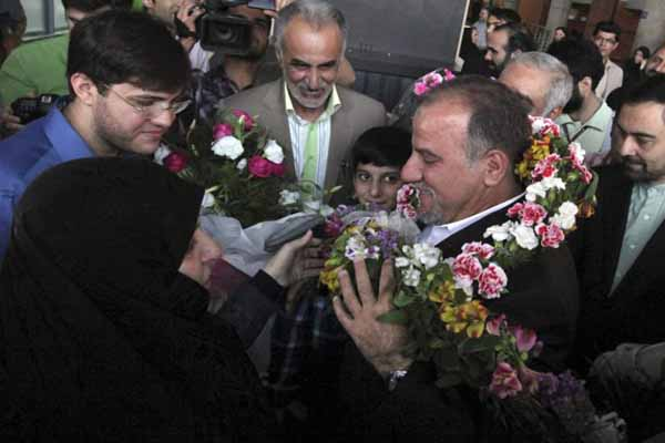 Iranian scientist freed by U.S. returns home