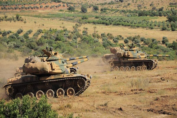Turkish troops near Syrian border are on high alert