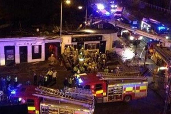 Police helicopter crashes into Scottish pub