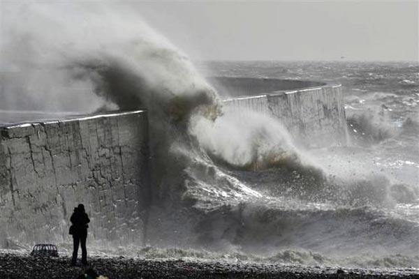 Two people killed as more storms batter Britain