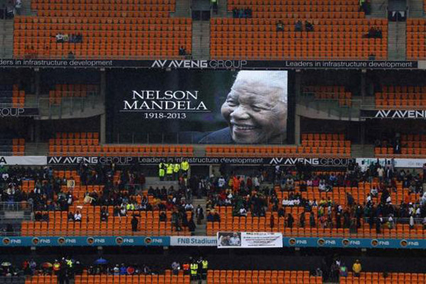 Leaders gather, thousands sing in rain in farewell to Mandela