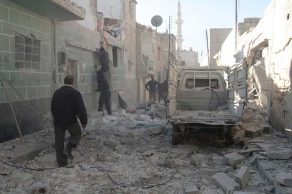 Death toll from Syria barrel bomb attack rises