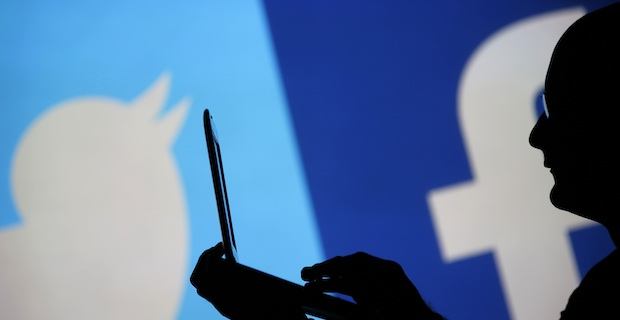 MPs call for tax on social media companies