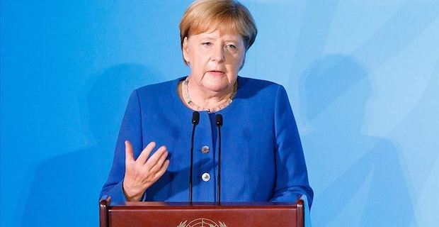 Merkel urges compromise between US, China