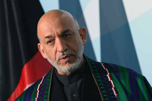 Kerry, Karzai extend talks on Afghan-US pact