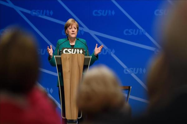 Chancellor Angela Merkel, SPD agree on timetable for coalition talks