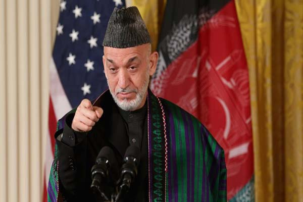 Karzai, 'US must stop their raids on our houses'
