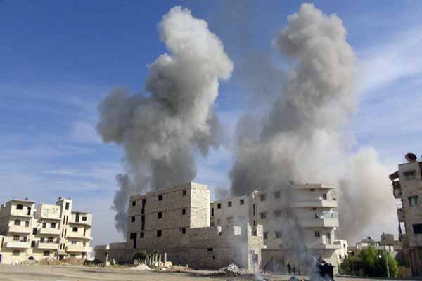 Assad forces bomb besieged town
