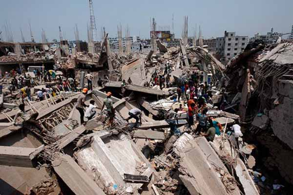 Bangladesh factory building collapse kills nearly 100
