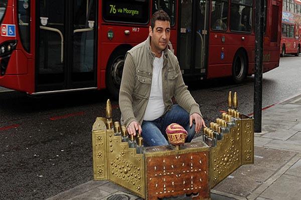 Turkish shoe polisher wins visa lawsuit against England