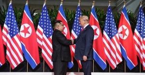 Trump and Kim open historic summit with handshake