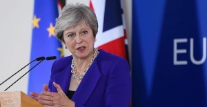 Theresa May vows to continue with her Brexit deal