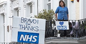 UK holds minute's silence for lost health workers
